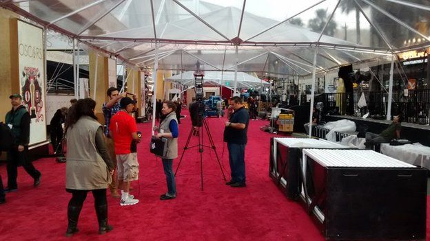 Clear plastic tents put up over the red carpet at the Oscars