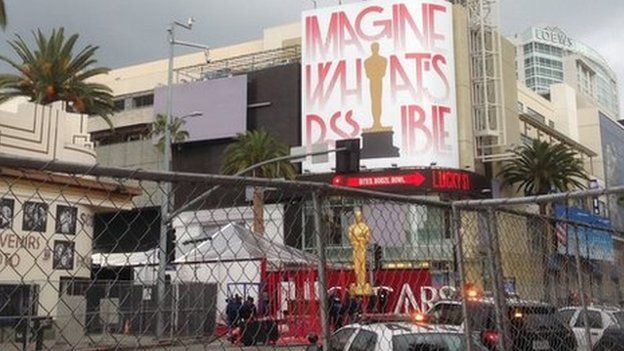 Final touches being made to the red carpet at the Oscars 2015