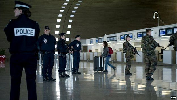 French soldiers and police patrol at the Charles de Gaulle airport in Paris - 17 January 2015