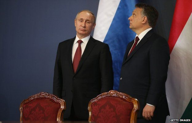 President Putin (L) with Mr Orban during his trip to Budapest (17 Feb)