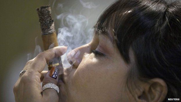 Cigar sommelier Ivonne de La Puente, 47, smokes a cigar during the XVII Habanos Festival in Havana, February 23, 2015