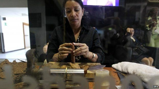 A woman assembles a cigar during the opening day of 17th Cigar Festival and Commercial Fair in Havana, Cuba, 23 February 2015