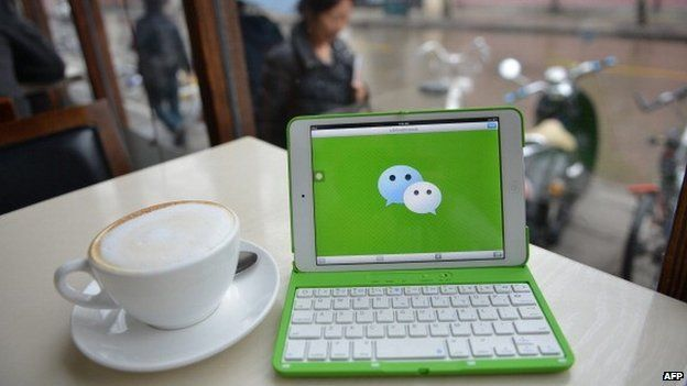 This photo illustration taken on March 12, 2014 shows the logo of Chinese instant messaging platform called WeChat on a mobile device which has taken the country by storm in just three years.