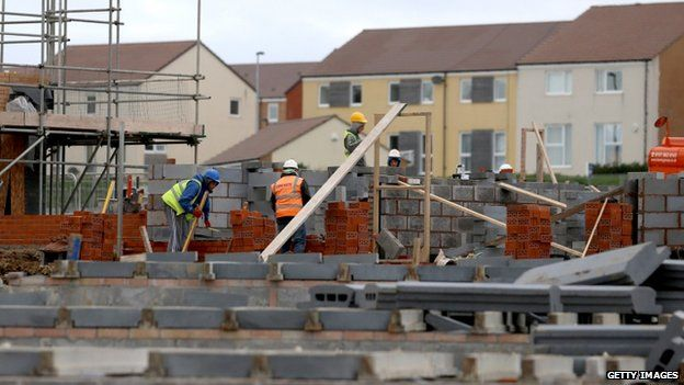 Builders constructing new houses