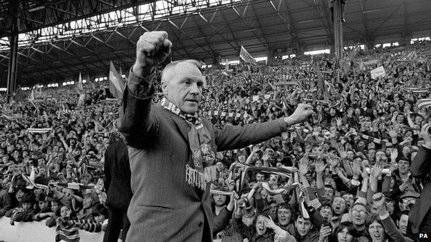 Bill Shankly turning towards the Kop end of Anfield, he gets an ovation from the fans who idolised him when Liverpool became League champions.