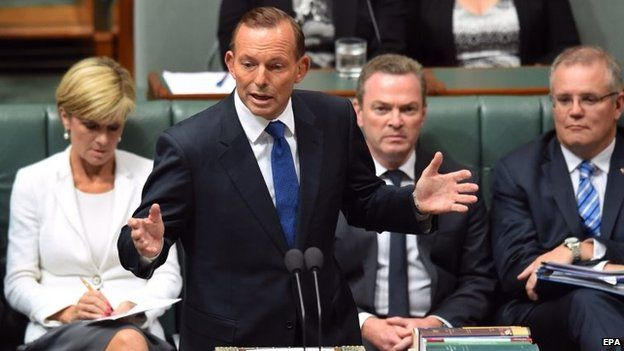 Australian Foreign Minister Julie Bishop (L), Education Minister Christopher Pyne (2-R) and Social Services Minister Scott Morrison (R) listen as Australian Prime Minister Tony Abbott answers questions at the despatch box during Question Time at Parliament House in Canberra, Australia, 23 February 2015.