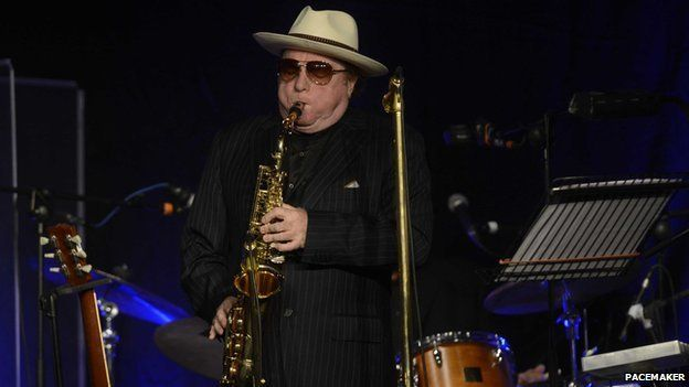 Van Morrison playing the saxophone at his old Belfast high school in 2014