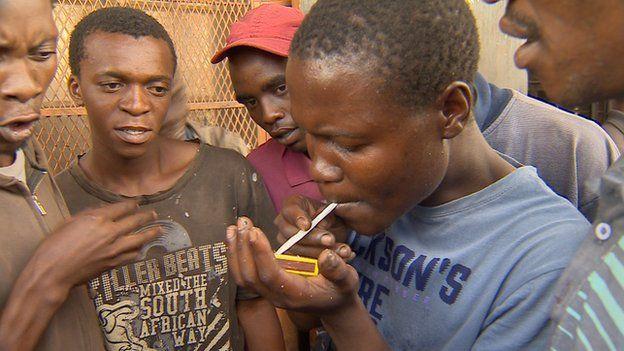 A young man smokes nyaope in Delmas, Mpumalanga