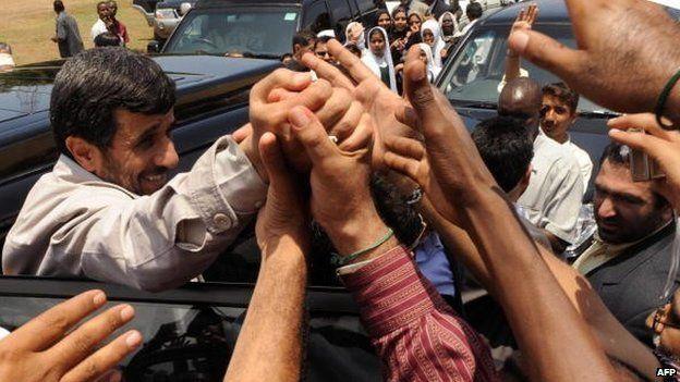 Iran's President Mahmoud Ahmadinejad greets members of the Shia community before addressing them on 25 February 2009 in Kenya's coastal town of Mombasa