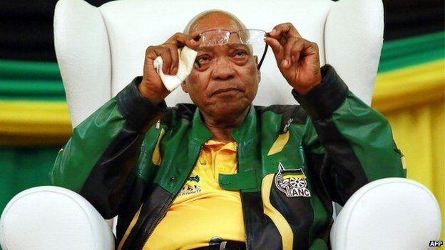 South African President and African National Congress (ANC) President Jacob Zuma cleans his glasses during a campaign event at the Inter-fellowship Church in Wentworth township, outside of Durban, on 9 April 2014