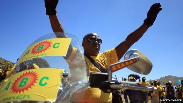 A biker supporter of Lesotho's All Basotho Convention (ABC) cheers on February 22, 2015 in Maseru, Lesotho