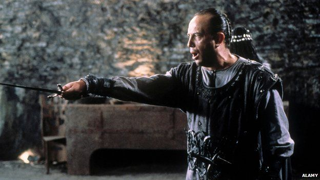 Scene from Macbeth showing title character clutching dagger
