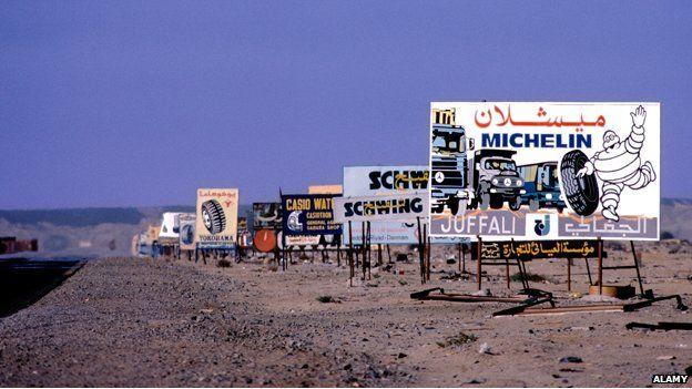 Roadside adverts along a desert road