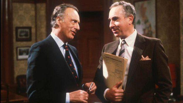 Actors Paul Eddington as fictional Prime Minister Jim Hacker, and Nigel Hawthorne as Sir Humphrey