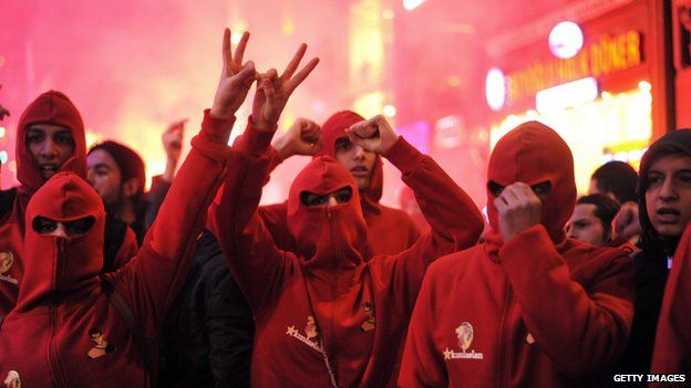 Protesters shout slogans and gesture during a protest against Turkish government's newly proposed restrictions on the use of internet, on Istiklal avenue in Istanbul, on February 8, 2014