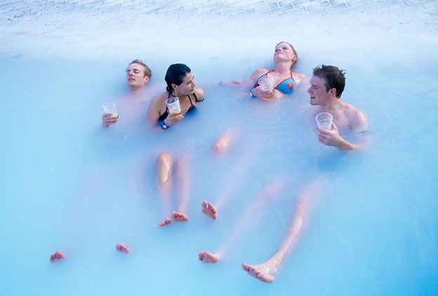 People drinking beer in the blue lagoon