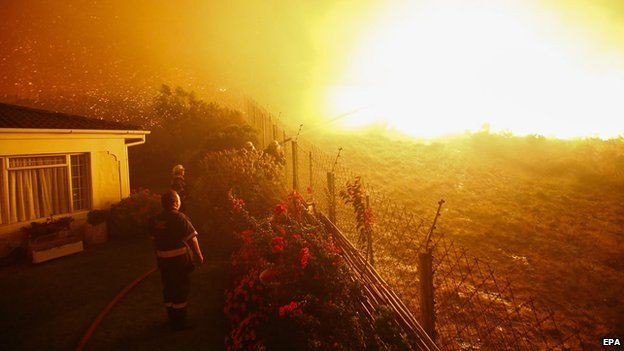 A firefighters tries to stop a blaze in Noordhoek Manor old age home, Cape Town, South Africa, 02 March 2015