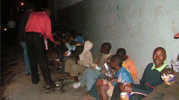 Clifford Oluoch feeding homeless people in Nairobi, Kenya