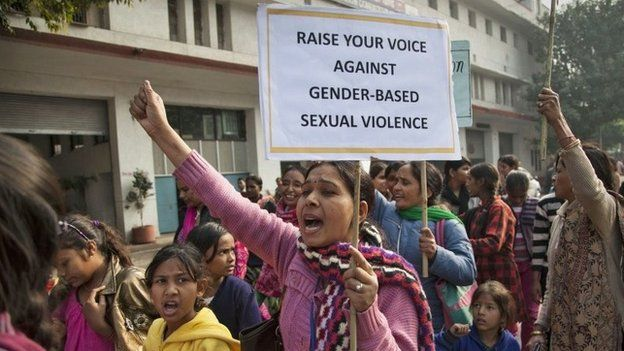 """Activists of Apne Aap, a non-governmental organization which addresses to women""""s rights, shout slogans during a protest ahead of the second anniversary of the deadly gang rape of a 23-year-old physiotherapy student on a bus, in New Delhi, India, Monday, Dec. 15, 2014."""