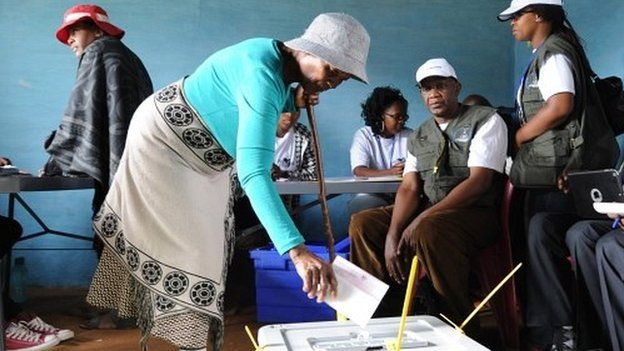 A voter casts her ballot in Maseru, Lesotho, Saturday 28 February 2015