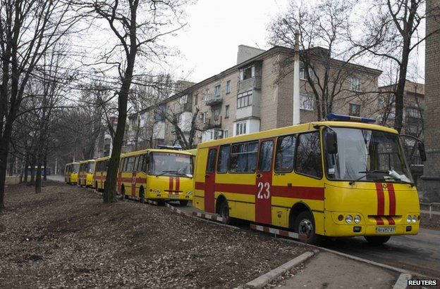 Emergency vehicles stand outside the Zasyadko mine, 4 March