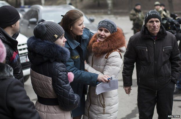Family members stand outside the Zasyadko mine, 4 March