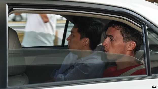 Andreas Von Knorre, one of the two German nationals arrested in Singapore for vandalism, arrives in a police car to the state court on 22 November 2014