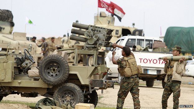 Shia fighters load a rocket launcher in Salahuddin province. 4 March 2015