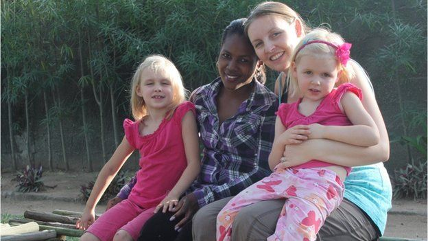 Becky Wakely with her two daughters, Gracie and Honor, and a friend in Mozambique