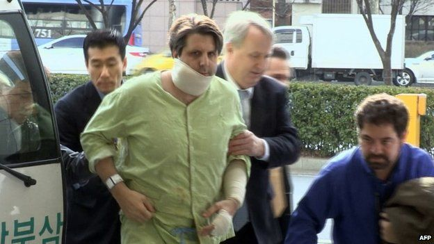 A screen capture of Yonhap News TV made and released by Yonhap on March 5, 2015, shows the US ambassador to South Korea, Mark Lippert (C), arriving at a hospital in Seoul after receiving emergency treatment for injuries caused by a knife attack by an armed assailant.