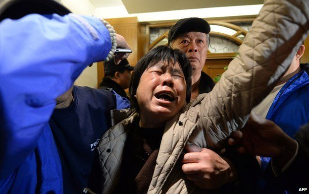 Relatives of passengers on Malaysia Airlines flight MH370 react to the news that the plane plunged into Indian Ocean at a hotel in Beijing on March 24, 2014