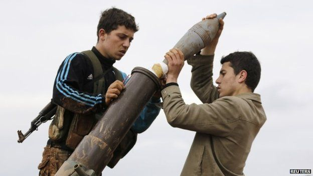 Nusra Front members prepare to fire a mortar towards forces loyal to Syrian President Bashar al-Assad north of Aleppo