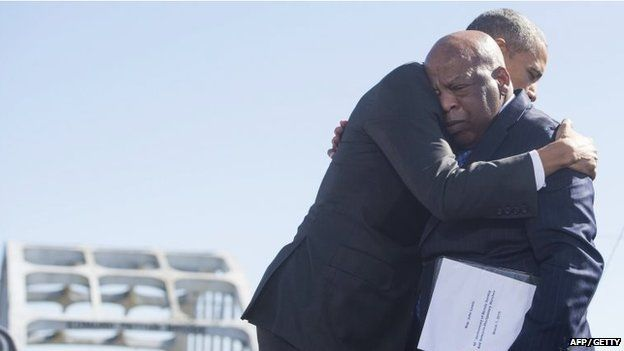 US President Barack Obama (R) hugs US Representative John Lewis, Democrat of Georgia in Selma in March 2015