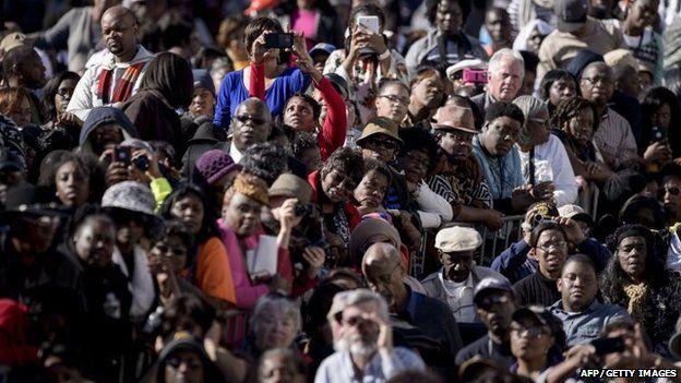 People listen as US President Barack Obama speaks at the Edmund Pettus Bridge on March 7, 2015 in Selma, Alabama.