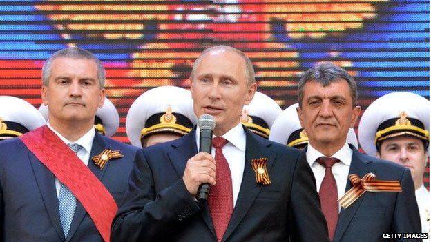 Russian President Vladimir Putin speaks during his visit to the Crimean port of Sevastopol on 9 May 2014