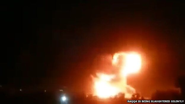 Video posted by Raqqa is Being Slaughtered Silently purportedly showing fireball in sky after air strike on oil refinery outside Tal Abyad, Syria (8 March 2015)