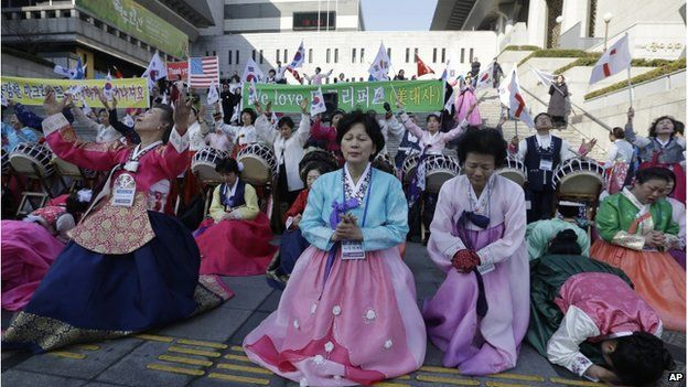 South Korean Christian women pray for the speedy recovery of U.S. Ambassador to South Korea Mark Lippert, during a gathering near the U.S. embassy in Seoul, South Korea, Saturday, 7 March 2015