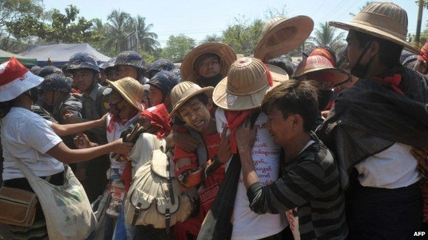 Myanmar student protesters and nationalists clash with riot police during a march in Letpadan town, north of Myanmar's main city on 10 March, 2015