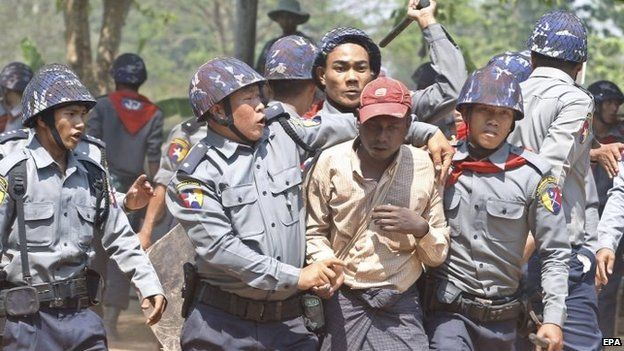 Police arrest a student protester at the protest site in Letpadan, Bago division, Myanmar, 10 March 2015.