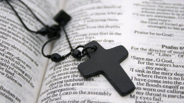 A cross on a bible