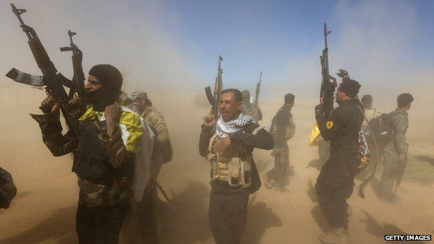 Iraqi fighters of the government-controlled Popular Mobilisation units gather on the western entrance of the Iraqi city of Tikrit during a military operation to take control of the city