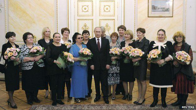 President Putin with a delegation of women