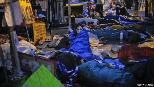 A demonstrator looks on as she spends the night at Sol Square Camp during a continued protest on 22 May, 2011 in Madrid, Spain