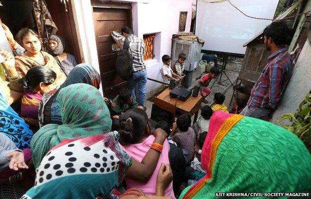 People watching the banned BBC documentary in Delhi slum, 12 March 2015