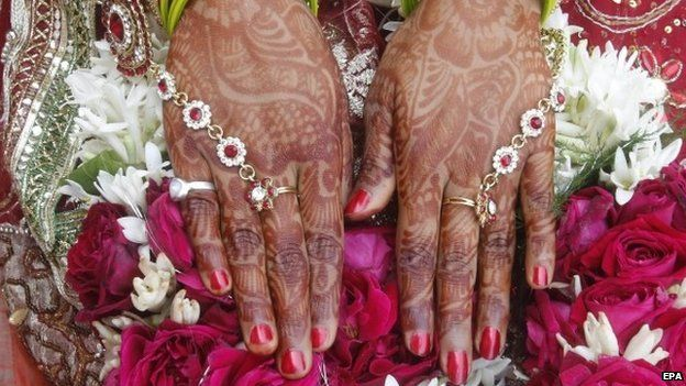 A close-up view of the hands of an Indian bride