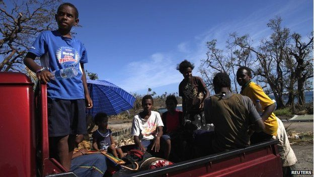 Children ride on a truck in Lenakel town after Cyclone Pam struck in Tanna, about 200km from Port Vila, capital of Vanuatu March 17, 2015