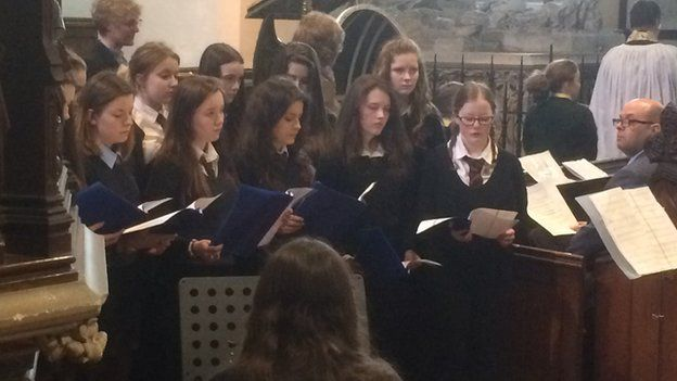 Queen Elizabeth High School choir perform at the service