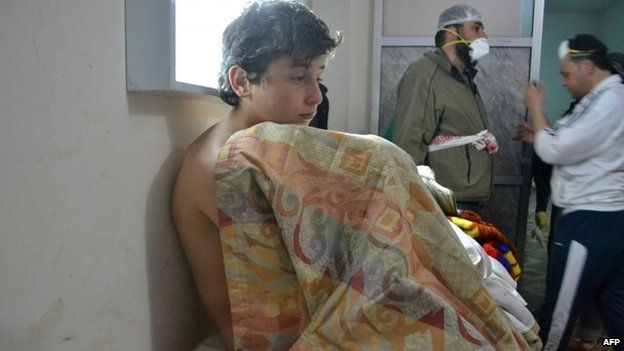 A young Syrian sits on a bed at a clinic after a suspected chorine attack in Sarmin, Idlib province, Syria (17 March 2015)