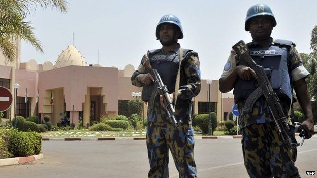 UN peacekeeper police officers stand guard at entrance of Hotel Salem in Bamako on March 8, 2015