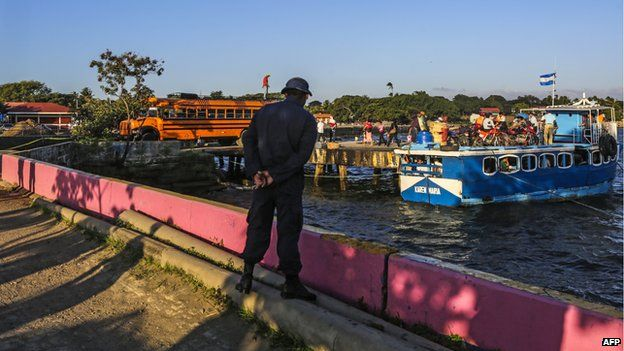 A navy soldier watches the boats depart from Lake Nicaragua on 11 December, 2014